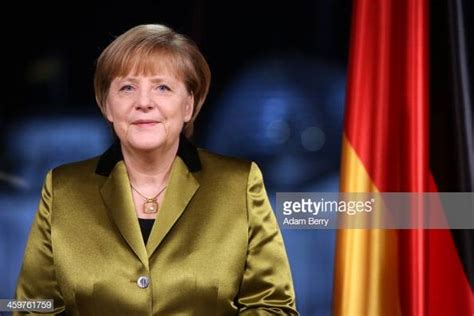 German Chancellor Angela Merkel poses moments after giving