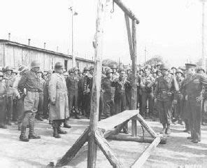 A Dutch survivor of Ohrdruf shows the camp's gallows to US